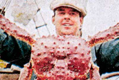 Paddy Mullan holding king crab, 1966
